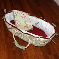 Cute and Convenient    New moms love moses baskets due to their easy portability to any place This maze-style basket is adorned with 100 cotton bedding featuring an adorable emroidered elephant on the bumper as well as a red and green blanket with stimulating pictures of safari animals Perfect for any season any new mom will be thrilled to keep her little one close by in the Antique Embroidered Moses Basket