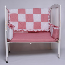 Gingham Color Our Gingham Eyelet Porta Crib Bedding is a classic beauty Featuring a bold patchwork design of alternating gingham and white eyelet A beautiful ruffled comforter bumper and fitted sheet complete the set Machine washable for your convenience our set is all comfort