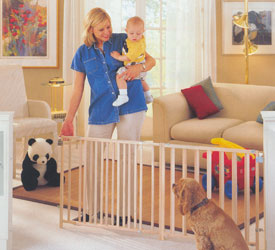 Deluxe Wooden Gate Expands To Fit Extra-Wide Openings  This 27H x-tra wide swing gate keeps curious kids safe from stairways and off-limits areas and its unfinished wood surface makes it a sophisticated addition to any doorway  The slat design discourages climbing and opens with a childproof latch thats easy for adults to pop with one hand No more straddling or jumping over the gate: it can be set to easily swing in out or both ways with the control hinge Gate removes easily from anywhere Great for pets too  Secure 4 point steel mounting hardware