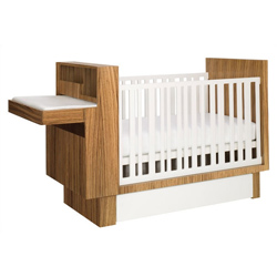 Style and Function Combined What an amazing combination of function and style Our Studio Crib is a chock full of convenient features A modern crib resting on a platform base boasting an under crib drawer creates a truly striking effect From one end of the crib a hideaway changing table extends complete with changing pad and cabinet below Our crib easily converts to a toddler daybed and desk for your lasting enjoyment The perfect addition to your modern nursery  Fixed side rail Under crib drawer Changing table hideaway cabinet Changing table lowers slowly and easily Changing pad included Cabinet provides plentiful storage Converts to toddler daybed with built-in desk Hand crafted