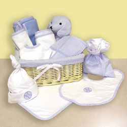 Every Essential    Beautiful and charming the Deluxe Gift Basket includes all the baby essentials a new mom needs The lined pink or blue basket includes a stuffed toy keepsake bag and a deluxe framed receiving blanket fleece receiving blanket and pique receiving blanket The set is completed with a jersey embroidered bib and hat and terry velour bib burp and wash cloth This wonderful gift basket comes beautifully wrapped in tulle and tied with with a ribbon Ideal for baby showers this delightful gift basket will thrill any new mom